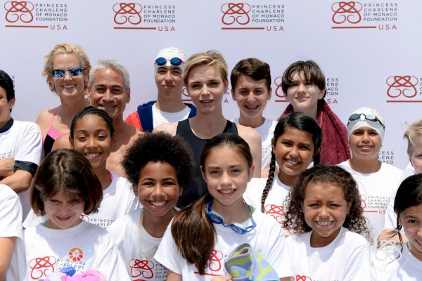 """""""SANTA MONICA, CA - MAY 11: U.S. Olympic Swimmer, Dara Torres, U.S. Olympic Diver, Greg Louganis and Founder, Princess Charlene of Monaco Foundation, Princess Charlene of Monaco teach children how to swim and practice water safety at The Princess Charlene of Monaco Foundation-USA Official Launch at the Annenberg Community Beach House on May 12, 2016 in Santa Monica, California. (Photo by Kevork Djansezian/Getty Images for Palais Princier de Monaco)"""""""